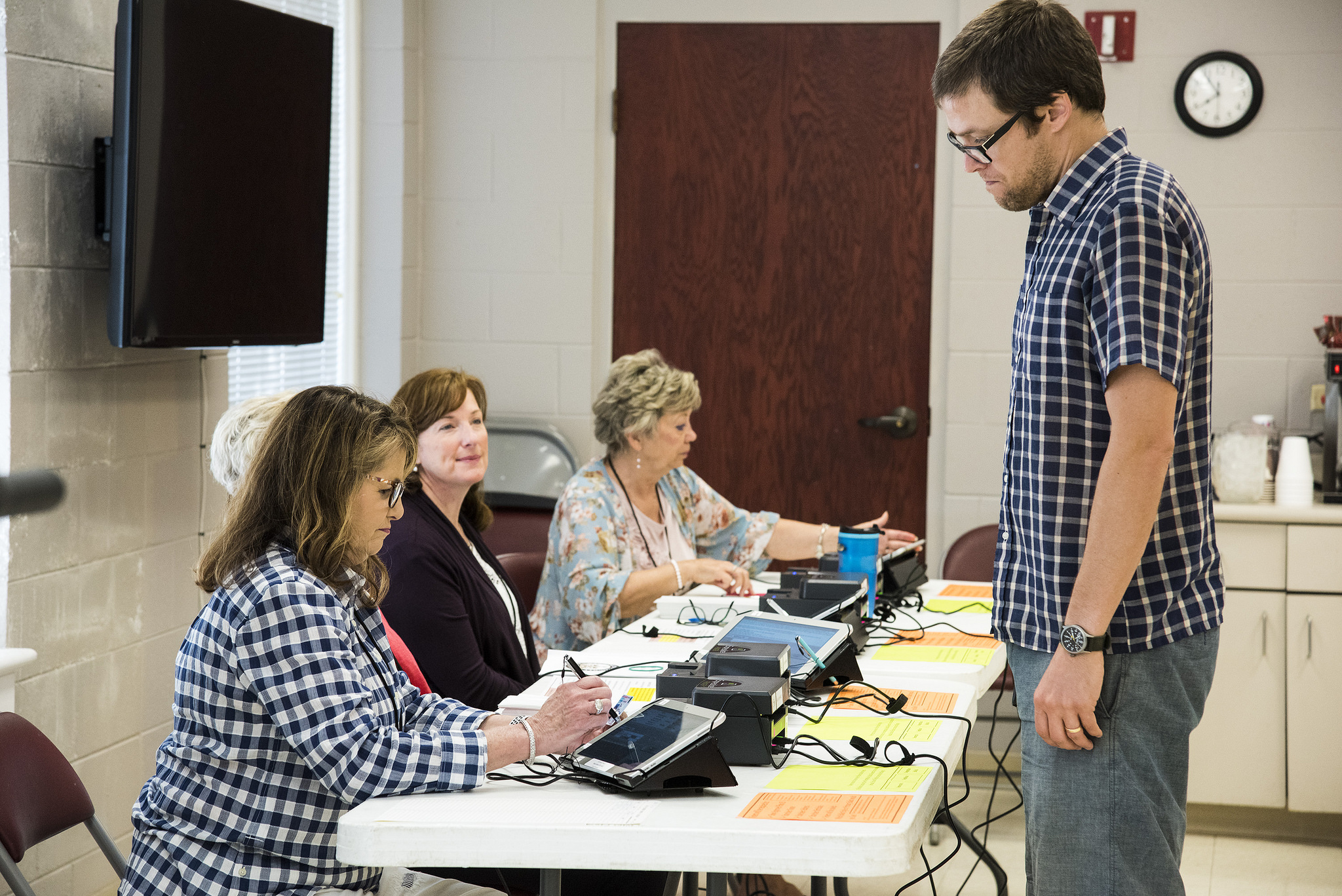 An Arkansas voter provides his information to poll workers