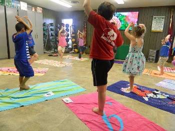 Kids practicing Yoga poses