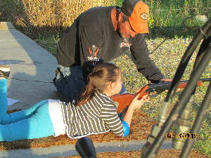volunteer leader assisting 4-H member in the County BB Shooting Contest