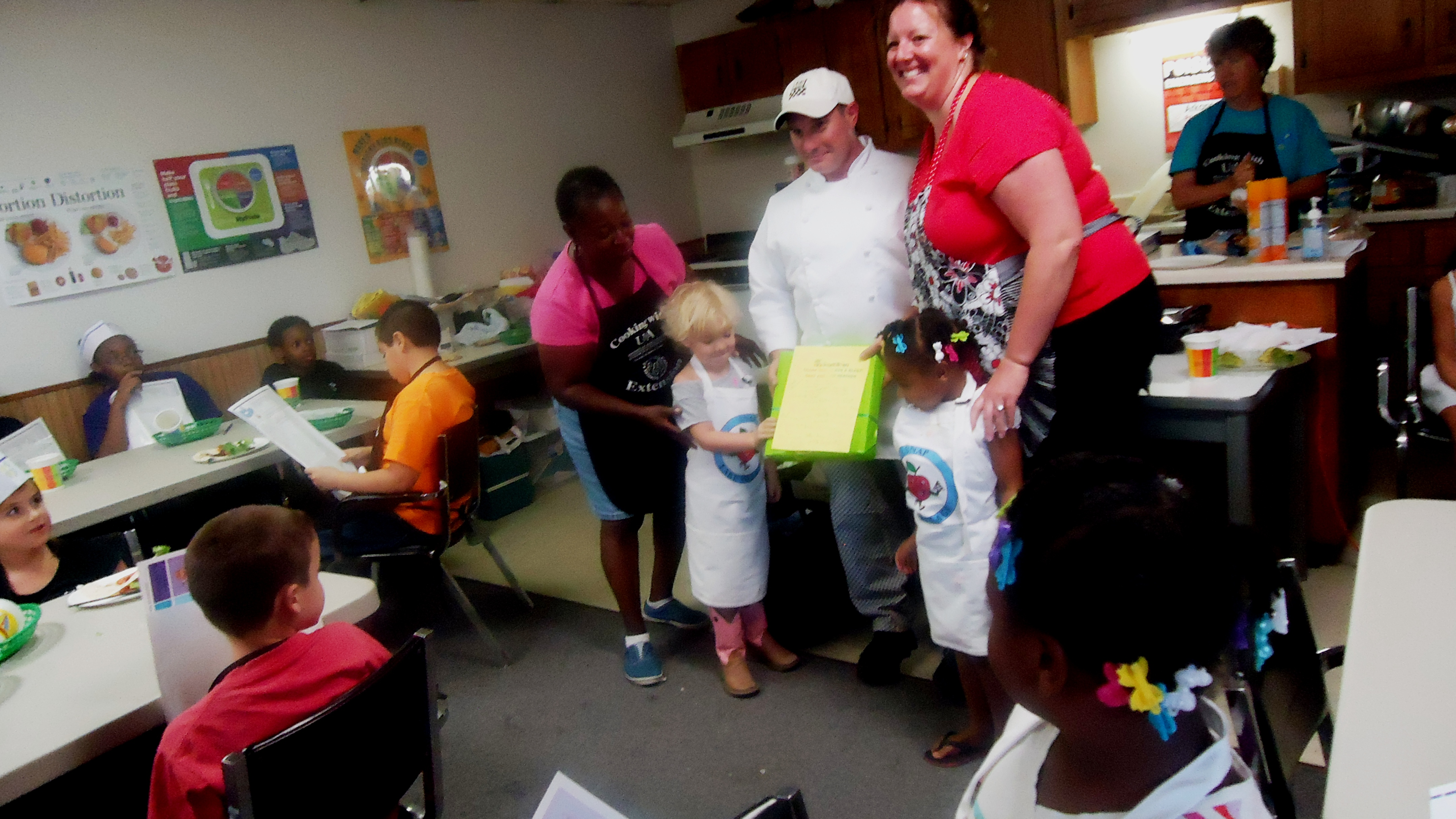 Picture of Chefs, Andy Gibson and Heather Gibson working with 4-H youth.