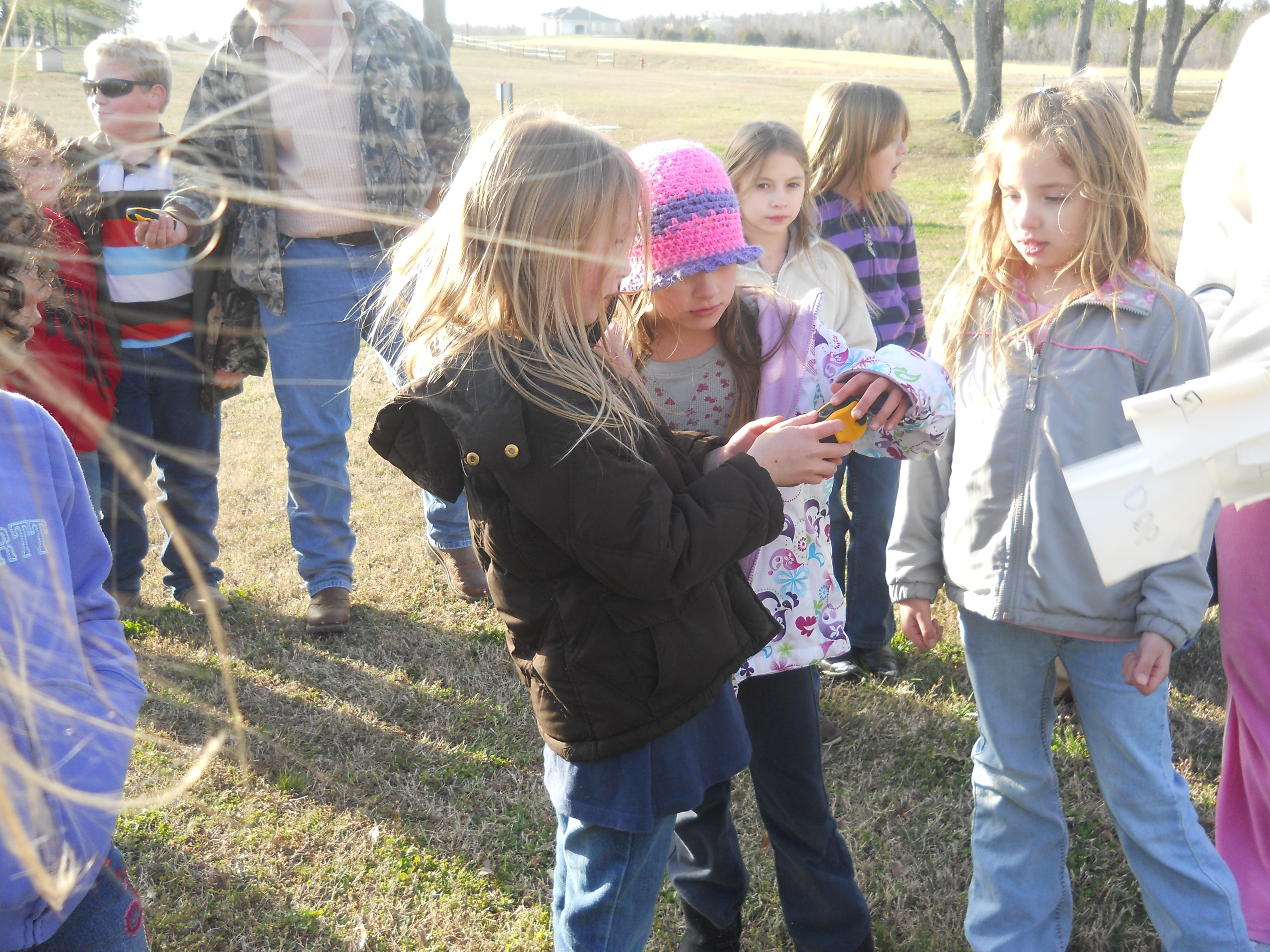 Clay County youth learning how to use hand held GPS unit
