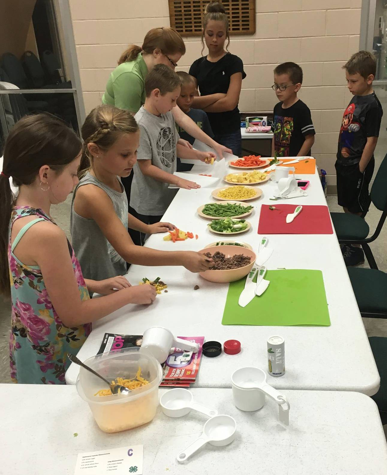 4-H Day Camp attendees learn about vegetables and healthy eating by putting together their own packet meals.