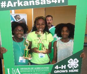 Delta District O'Rama Record Book Winners, 3 girls smiling holding trophies