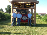 Drew County Whep participants standing in front of Arkansas State Flag and Bradford Research & Extension Center sign.
