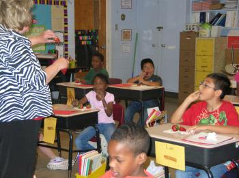 Agent teaching students in classroom about the SNAP program in Mineral Springs Arkansas