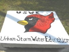 Picture of Robert F. Morehead Middle School Cardinal on storm drain art at Dollarway School