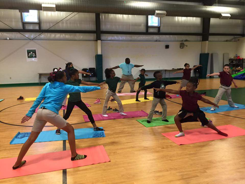 Jefferson County students practicing yoga.