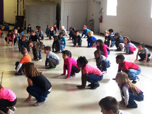 England Elementary students practicing Yoga