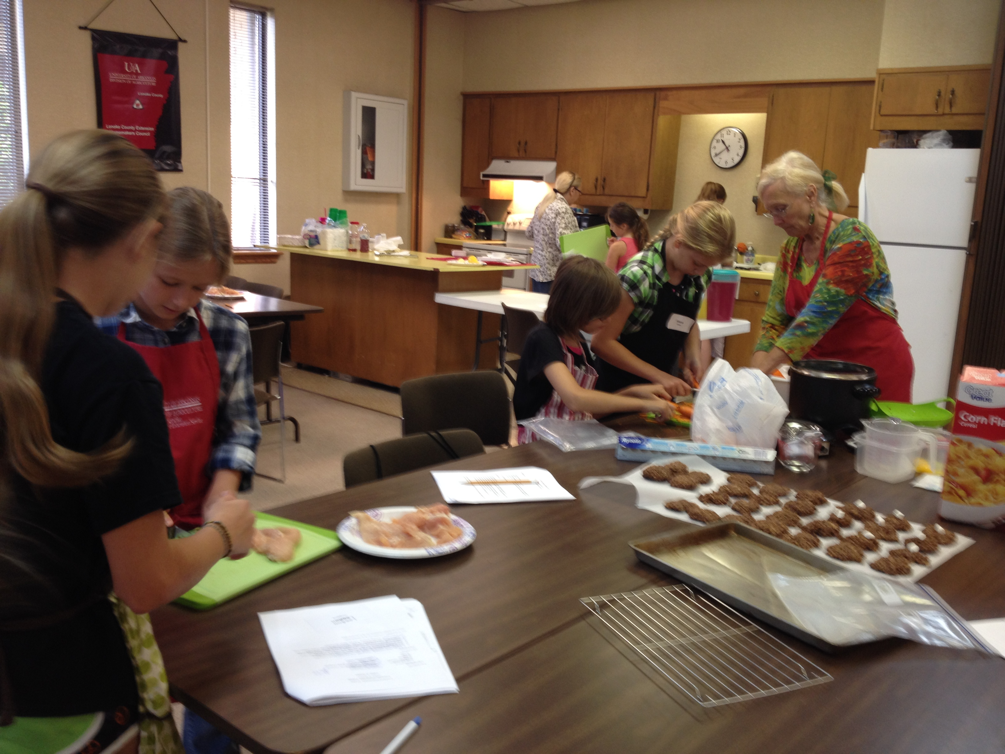 Youth preparing lunch at day camp