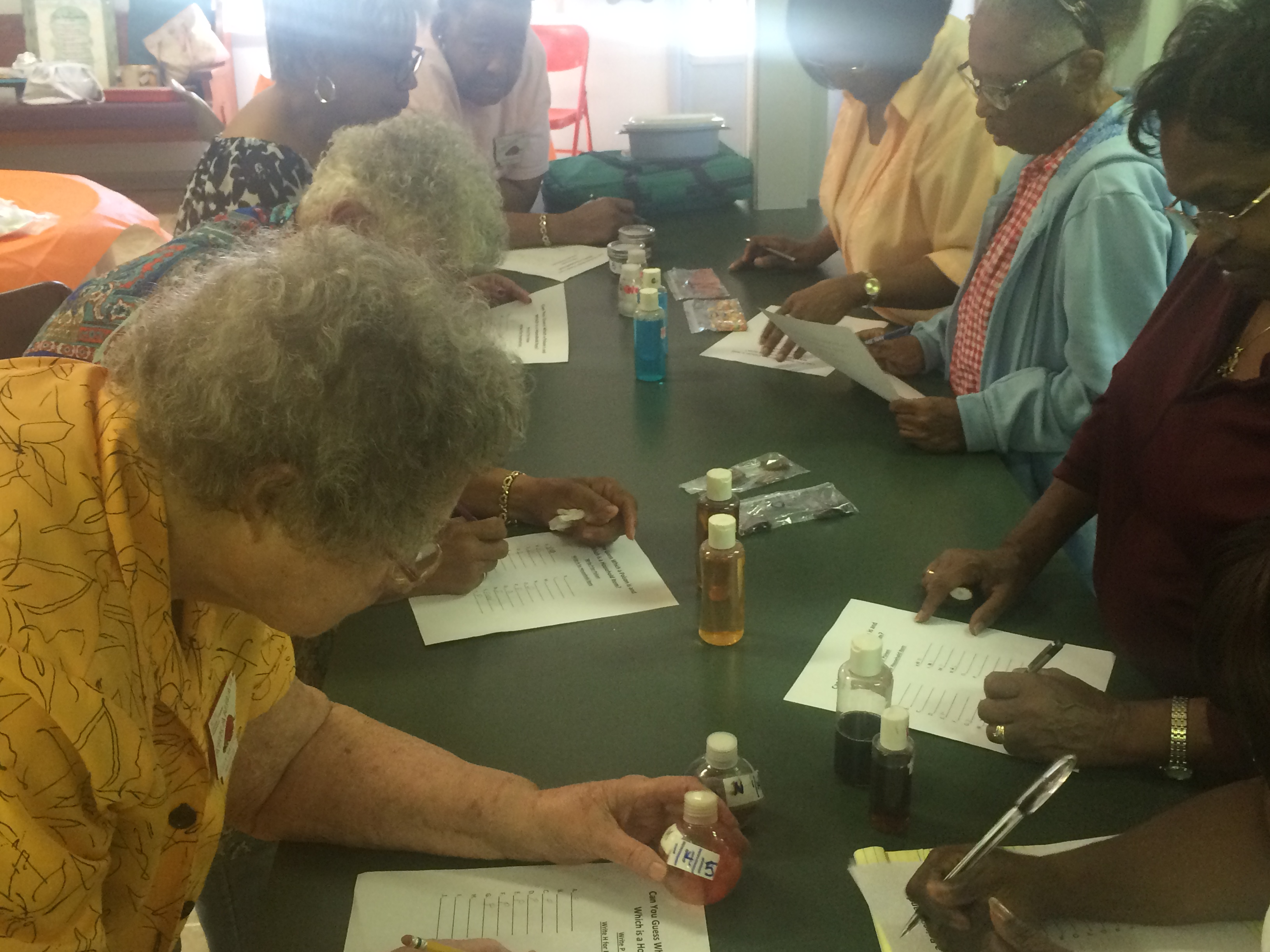 women viewing various containers of pills and liquids to tell the difference between poison and not