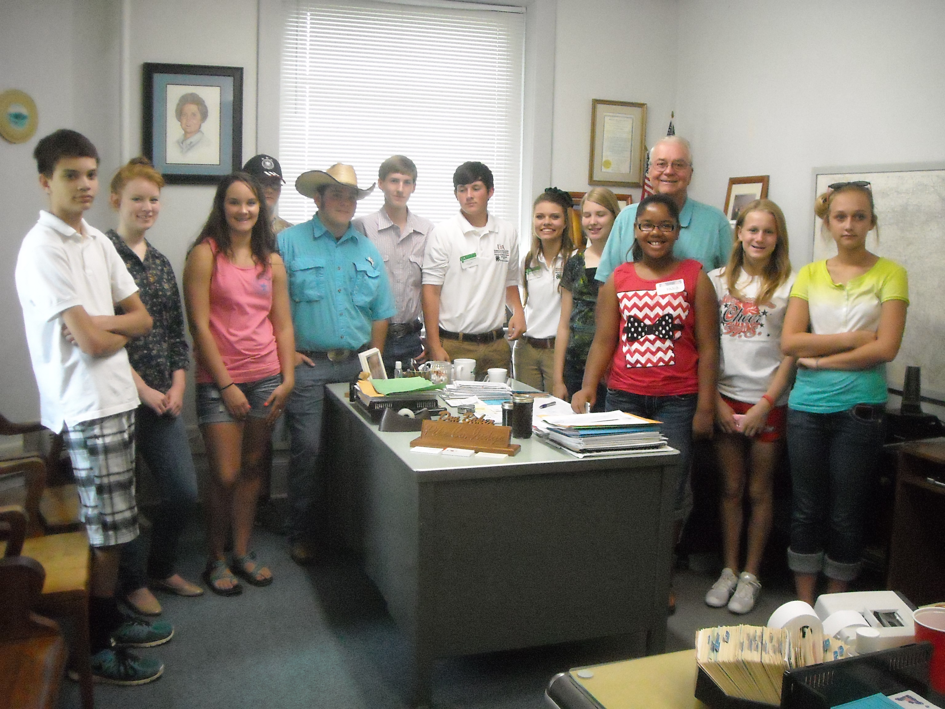 Pike County Judge Don Baker, with 4-H youth at the Pike County Courthouse during Citizenship Leadership Day.