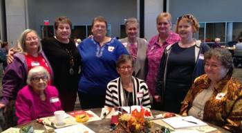 Saline County EHC members around the table at Ouachita District's President's Day.