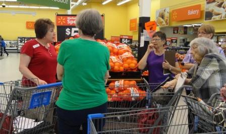 Agent Kris Elliott gives a Shopping Matters tour at a local grocery store.