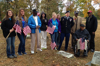 4-H members honored past Veterans by placing flags on their graves at the Woodlawn Cemetery.