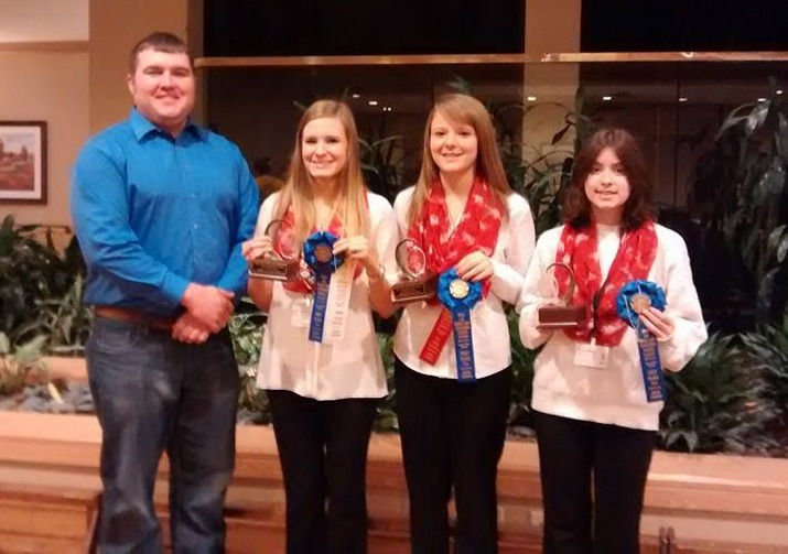 Four 4-H youth with prize winning poultry and ribbons at the 2012 AR State Fair