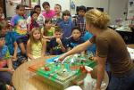 Group of elementary kids watching water quality presentation
