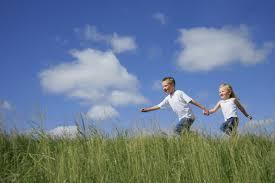 Air Quality | Environment & Nature | Arkansas Extension - blue sky, happy girl and boy holding hands while running in field of tall grass