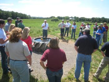 Speaker discussing alternative livestock watering trough in Arkansas.