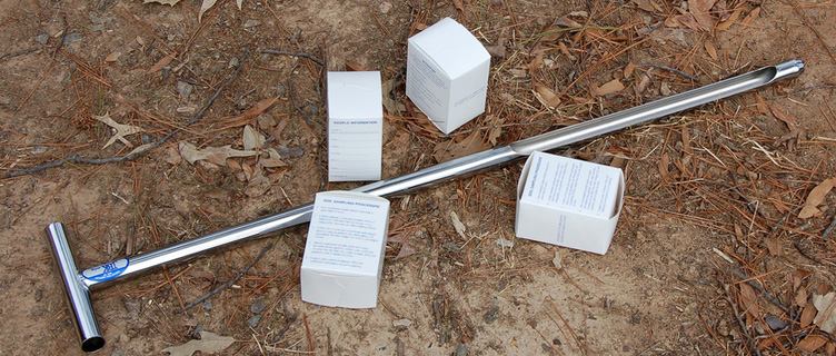 Soil probe and boxes for soil samples on the ground