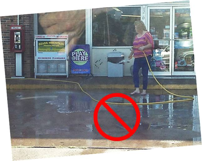 Cleaning Parking Lot with Hose