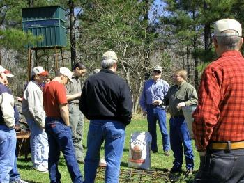 Wildlife biologist discussing food plots to crowd