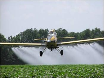 Photo of a crop duster preforming an Aerial Application