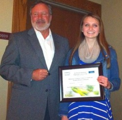 Northeast Arkansas Science fair winner smiling and holding a certificate