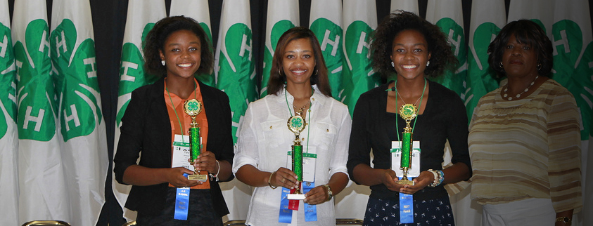 Three young ladies receiving awards.