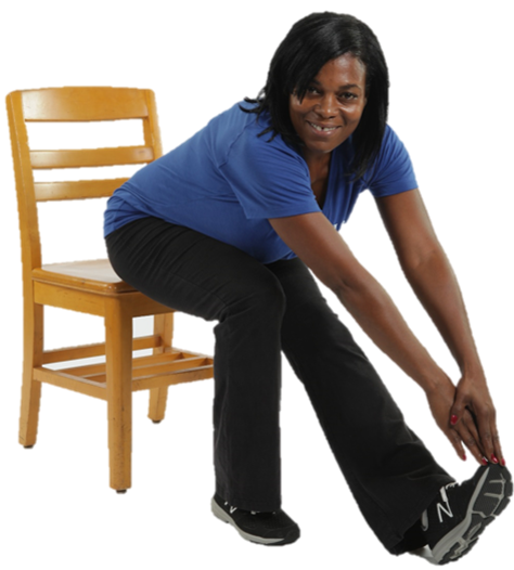 woman sitting in a chair stretching her leg