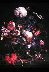 Picture of a painting with and arrangement of tulips.