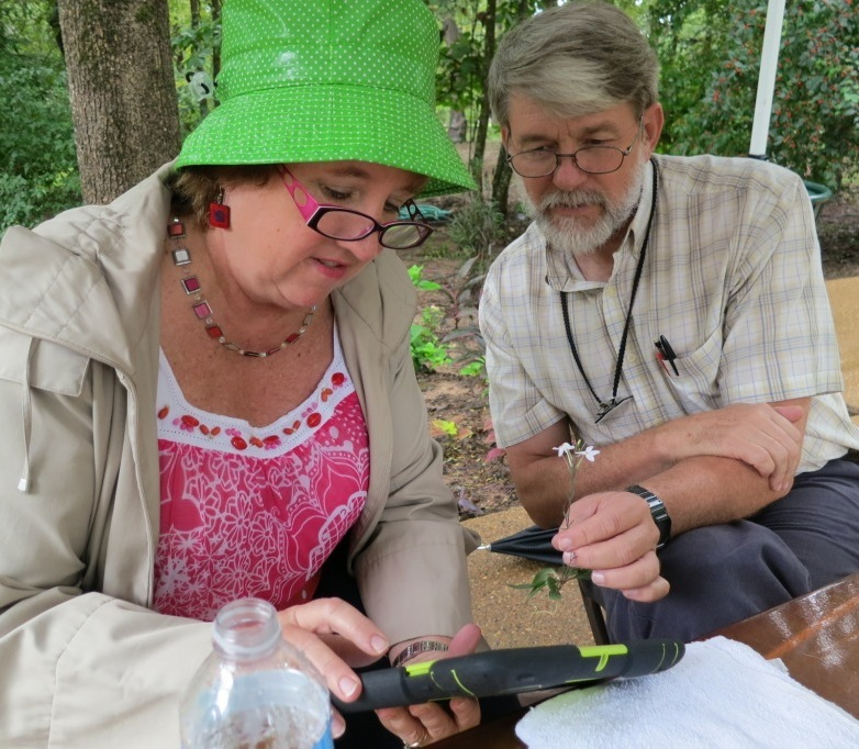 Photo of Janet Carson and Bob Byers identifying a flower from Garvan Woodland Gardens in Hot Springs, AR.